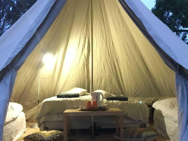 Glamping bell tent lit up from inside